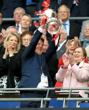 Manchester United manager Louis van Gaal lifts the FA Cup.