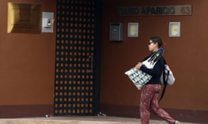 A woman walks past North Korea's embassy in Madrid