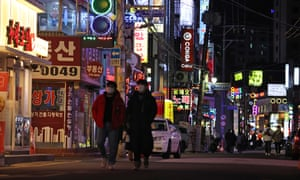 Cafes, restaurants and karaoke rooms are open late at night on a street in Seoul, South Korea, 15 February 2021.