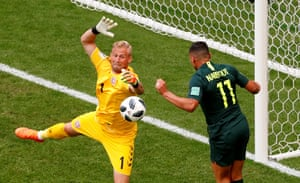 Kasper Schmeichel makes a save with Australia's Andrew Nabbout lurking.