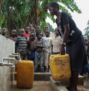 Women and children line up to access water from one of the new tap stands in Kasongo.