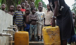 collecting water from a new tapstand in DRC