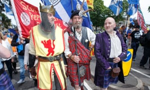 A man dressed as King Robert the Bruce takes part in an independence rally marking the 704th anniversary of the Battle of Bannockburn.