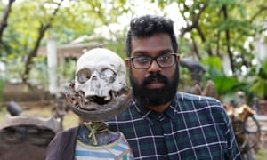 Boneheaded … Ranganathan with one of the statues that dot Port-au-Prince.