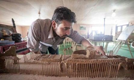 Syrian artist Mahmoud Hariri creates a model of Palmyra using clay and wooden kebab skewers.
