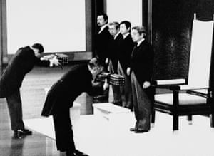 Emperor Akihito stands as court officials hand over the Sacred Sword and Jewel, symbols of the emperor, during the enthronement ceremony at the Imperial Palace in Tokyo in January 1989