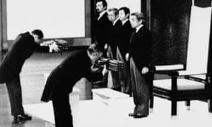 Emperor Akihito stands as court officials hand over the sacred sword and jewel, symbols of the emperor, at the enthronement ceremony in 1989 at the Imperial Palace in Tokyo