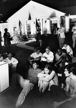 People sit on the lawn of the home of Stephen Armstrong in Wapakoneta, Ohio, to watch his son walk on the moon