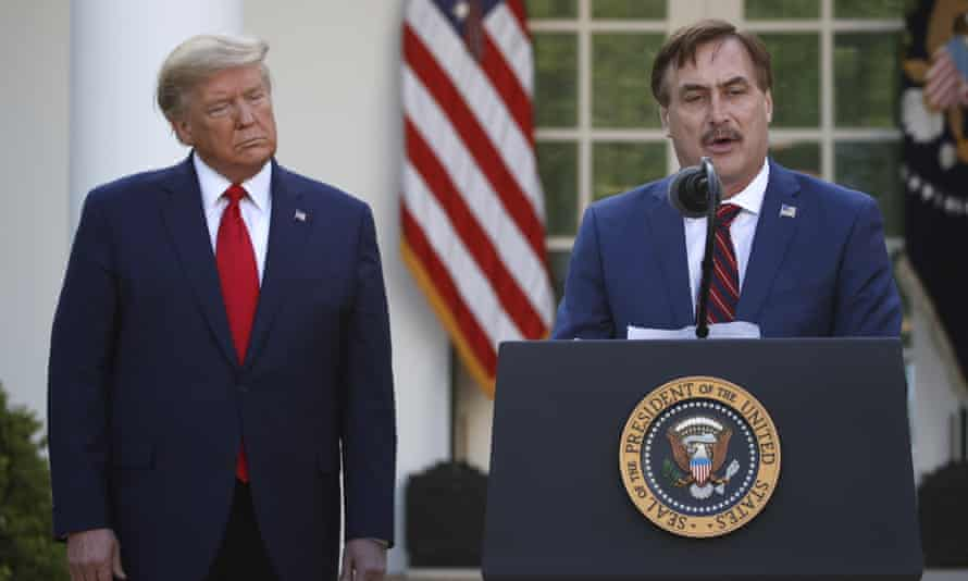 Mike Lindell speaks as Donald Trump listens during a coronavirus briefing at the White House on 30 March 2020.