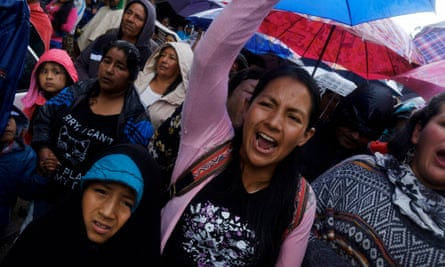 Women from Colombia's Kokonuko community accompany the coffin of Efigenia Vásquez, a Kokonuko journalist killed in October.
