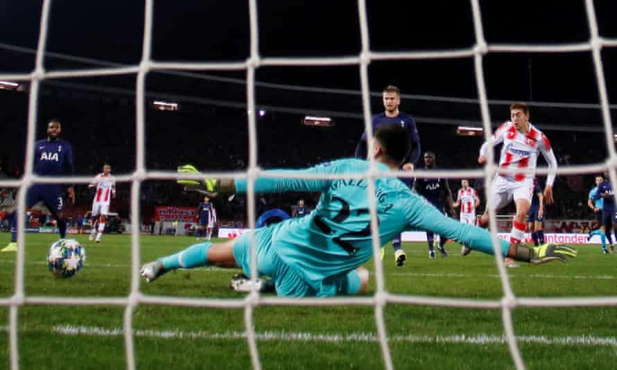 Paulo Gazzaniga stretches out a left boot to deny Red Star's Milan Pavkov in the first half.
