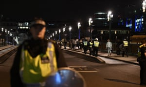 People are led to safety after terror attacks in London Bridge and Borough Market.
