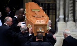 The coffin of Lyra McKee is carried into a Belfast cathedral for her funeral.
