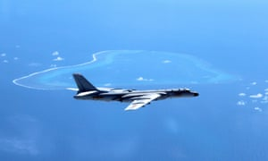 A Chinese H-6K bomber patrols the islands and reefs in the South China Sea