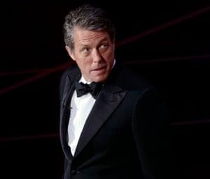 Hugh Grant presents the Bafta Fellowship to Ang Lee.