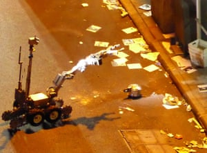 A police robot handles the unexploded pressure cooker bomb in West 27th Street in New York.