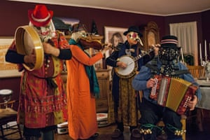 Interior shot of musicians mummering, St John's, Newfoundland. The earliest record of mummering in Canada is in 1819. It now takes place each year around Christmas.