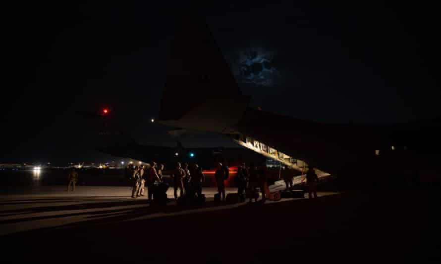 A RAAF evacuation flight loading passengers in Kabul. The RAAF C-130J Hercules aircraft departed Hamid Karzai International Airport on 18 August with just 26 people on board.