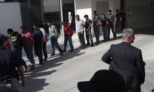 Undocumented immigrants leave a US federal court in shackles last week in McAllen, Texas.