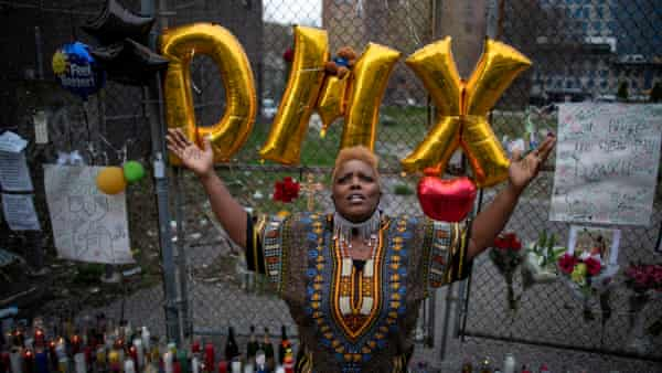 A woman at a memorial for musician and actor DMX outside White Plains Hospital in New York.