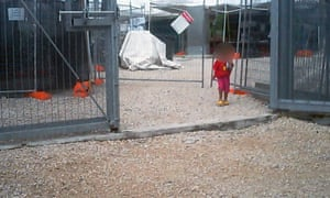 A young girl walks through the gates of the Nauru detention centre.