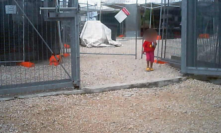 A young girl walks through the gates of the Nauru detention centre. The legality of the Australian government's offshore detention will be challenged in the high court.