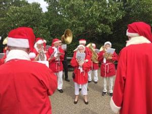 Musicians dressed as Santa Claus perform during the World Santa Claus Congress in Copenhagen