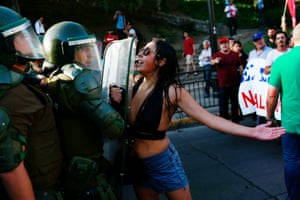 Santiago, Chile A demonstrator confronts riot police