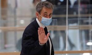 Nicolas Sarkozy leaves a Paris courthouse