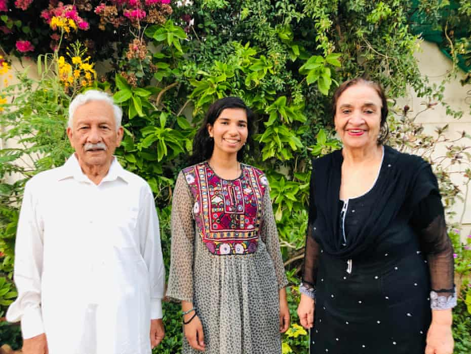 Nabihah Iqbal with her grandfather and grandmother at their home in Karachi, Pakistan