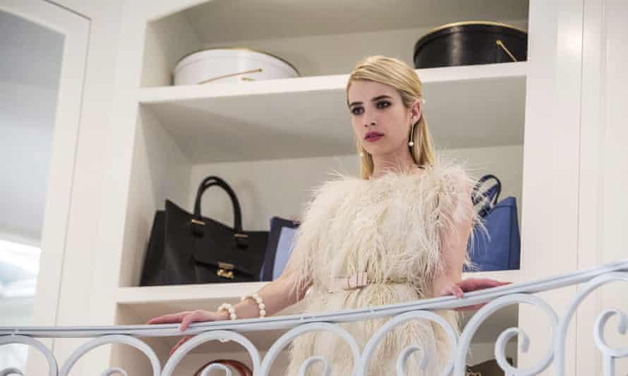 Chanel Oberlin surveys her closet in Scream Queens