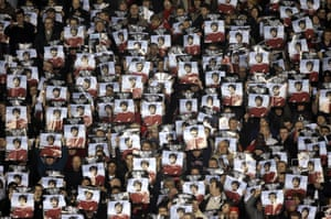 Manchester United fans at Old Trafford hold up tribute posters at their League Cup match against West Bromwich Albion five days after Best's death in 2005.