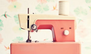 Close-up of vintage pink toy sewing machine