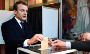 Emmanuel Macron casts his ballot at a polling station in Le Touquet, northern France.
