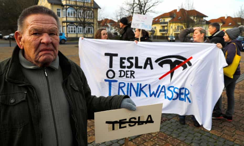 Demonstrators protest against plans by Tesla to build a Gigafactory near Berlin.