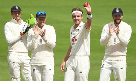 Stuart Broad salutes the empty stands at Old Trafford after dismissing Kraigg Brathwaite, his 500th Test wicket.