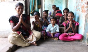 Amudha Managatti with her family in their new home in Villupuram. They were rehoused after spending several years on the town's station after fleeing Amudha's heavy-drinking husband