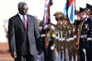 Manasseh Sogavare, prime minister of the Solomon Islands, inspects a guard of honour during a ceremonial welcome at Parliament House in Canberra. He and Malcolm Turnbull signed a security deal.