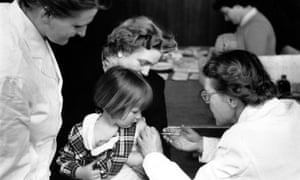 Schoolchildren throughout Britain are being injected with a vaccine to prevent polio, 1956.