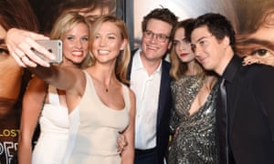 'I've spent the majority of my life in front of the camera': Karlie Kloss takes a selfie with her sister Kimberly and John Green, Cara Delevingne and Nat Wolff at the premiere of Paper Towns. She has just launched Klossy, a YouTube channel.