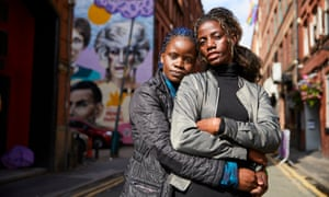 Megan Nankabirwa and her partner Lydia Nabukenya in Manchester's gay village.