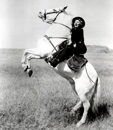 """""""May I feel your weapon?' Barbara Stanwyck in Forty Guns, 1957."""