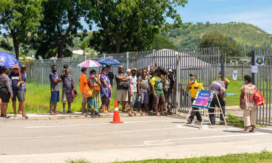 Port Moresby residents line up outside the Rita Flynn Sports Complex which has been reopened up as a Covid testing point in Papua New Guinea's capital.