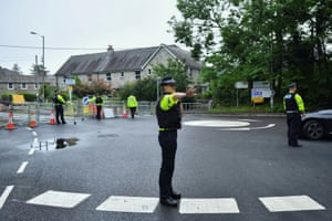 Police officers work at a roadblock outside Carbis Bay