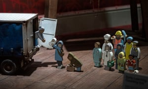 One of the items for sale from Banksy's homewares store: a children's toy where wooden migrant figures are loaded into a haulage truck
