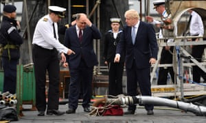 ommander Justin Codd accompanies Boris Johnson (right) and Defence Secretary Ben Wallace (centre) as they visit HMS Victorious at HM Naval Base Clyde