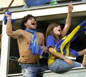 Maradona and his daughter Dalma celebrate after Boca Juniors' Martin Palermo scored against River Plate in March 2006, during their Clausura tournament match in La Bombonera stadium in Buenos Aires, Argentina