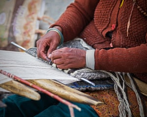Changpa women, who have given up the nomadic herding life, spend much of their time weaving in the back yards of their houses.