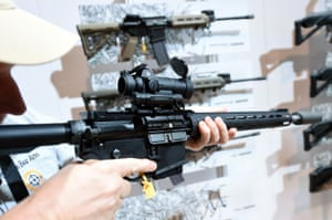 A convention attendee tries out a Predator SIGM400