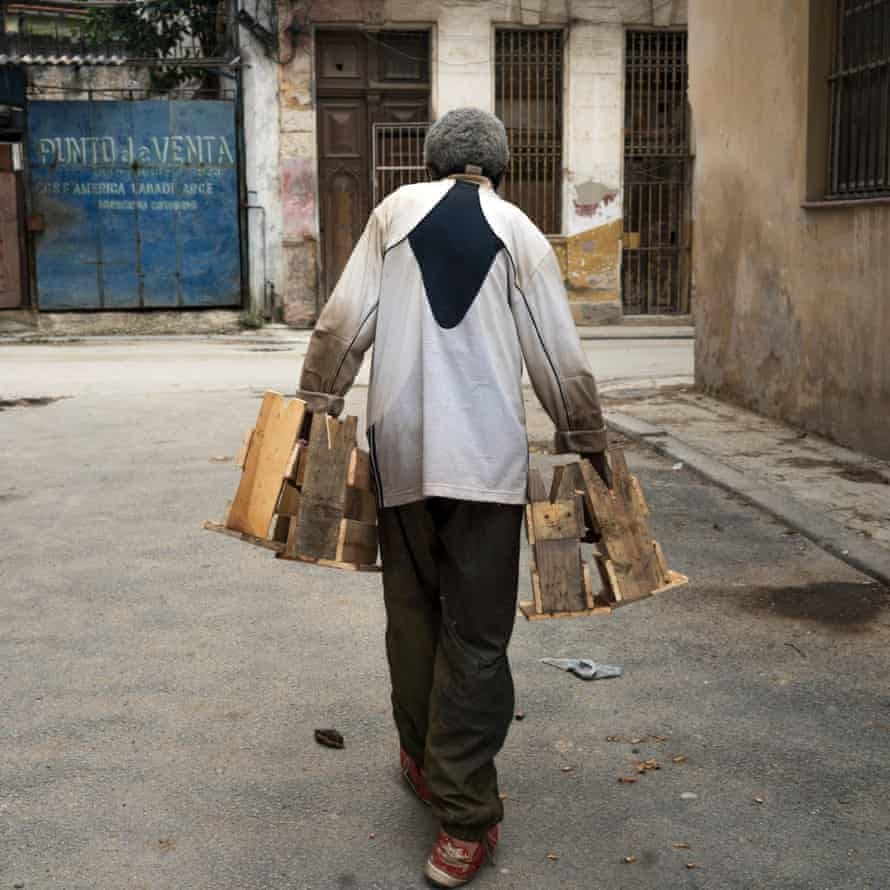 A man sells stools in Reunion Street